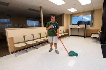 Man Mopping
